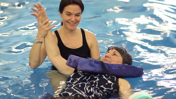 person doing aquatic therapy in water